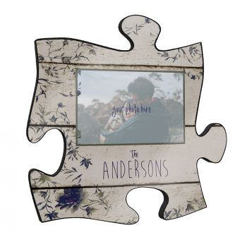 """This unique 12"""" x 12"""" wooden puzzle piece wall art allows you to add your favorite photo along with your last name."""
