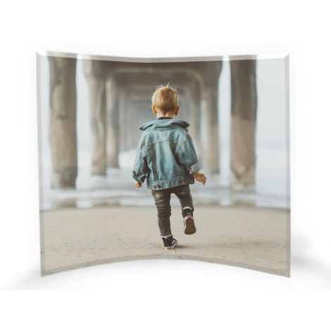 Our curved glass photo prints feature your favorite image upload fused into a free-standing, light-catching tabletop work of art.