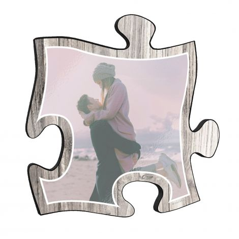 "This 12"" x 12"" wooden puzzle piece wall art has a large area to upload your favorite picture with a printed white wood design framed your image."