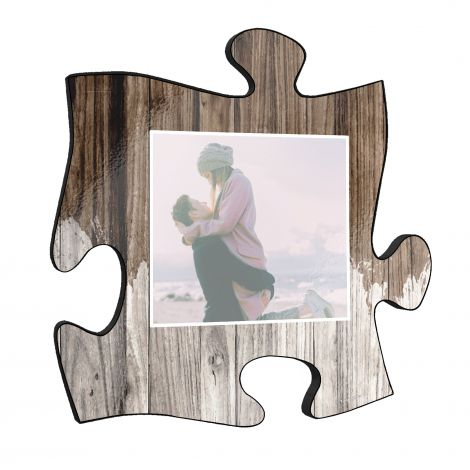"This 12"" x 12"" wooden puzzle piece wall art has an area to upload your favorite picture with a printed distressed wood design framed your image."