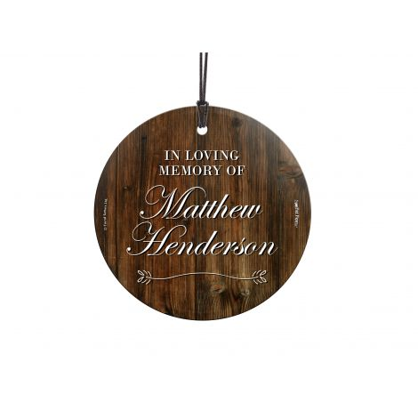 Losing a loved one is never easy. Now, you can remember them forever with this personalized hanging glass ornament. Add their name and year they left to make a keepsake that will last forever, complete with a wood background. Comes with hanging string for