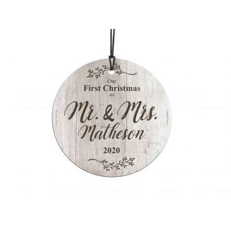 Congratulations! You're celebrating your first Christmas as a married couple! This sweet image of white wood and sprigs of nature, featuring your family name and year, is fused directly and permanently into glass for a light-catching, long-lasting keepsak
