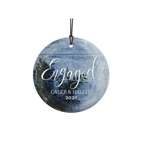 Congratulations! You're celebrating your first Christmas engaged! This frosty image of sprigs of green and a icy blue background, featuring your names and year, is fused directly and permanently into glass for a light-catching, long-lasting keepsake. Come