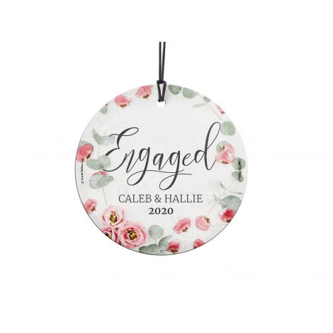 Congratulations! You're celebrating your engagement! Get your names along with the year featured with a pink floral image that is fused directly and permanently into the glass for a light-catching, long lasting keepsake. Comes with hanging string for easy