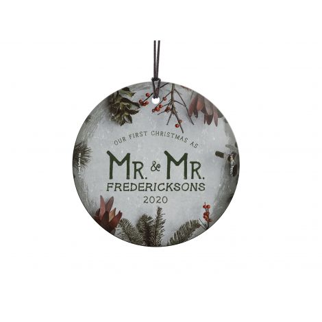 Celebrate your first Christmas married with this frosty green and cranberry decoration.
